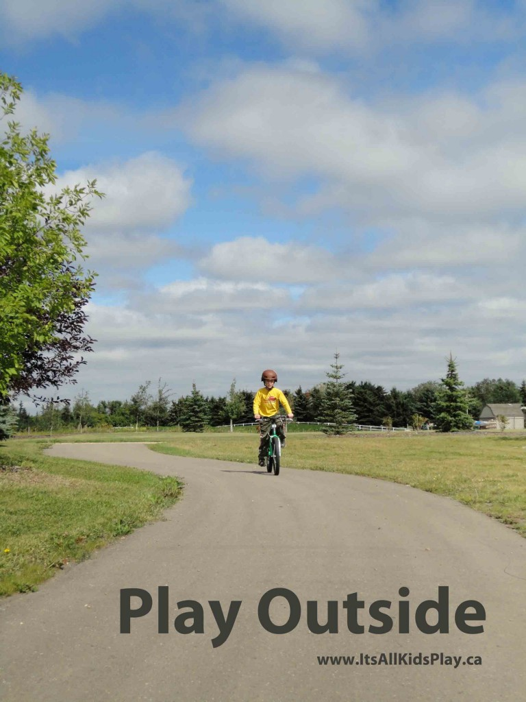 Outside play for kids--boy on bike