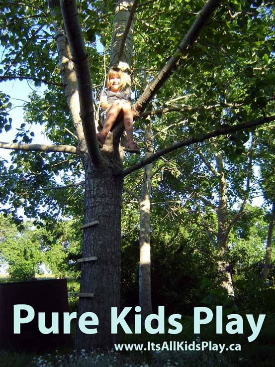 Free play that is pure kids play --picture of a girl in a tree